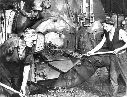 Two men stoking the boilers at the Oxford Gas Works near Folly ...